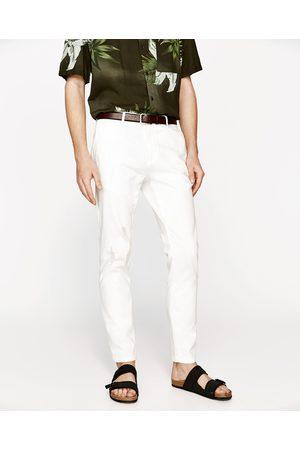 Homem Calças Chino - Zara CALÇAS CHINO RASGADAS - Disponível em mais cores