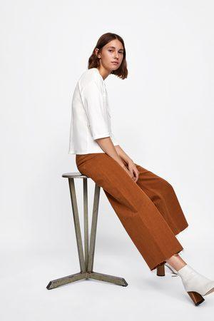 Zara T-SHIRT COMBINADA COM BOLSO