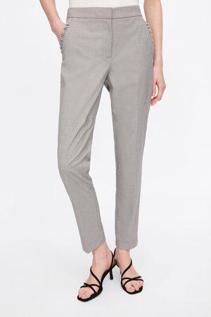 Zara Calças skinny com folho nos bolsos