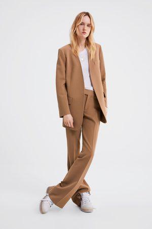 Zara Casaco com bolsos com aba