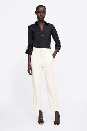 Zara Camisa básica com bolsos