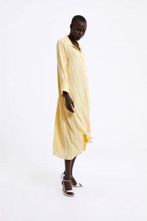 Zara Vestido às riscas com bolsos