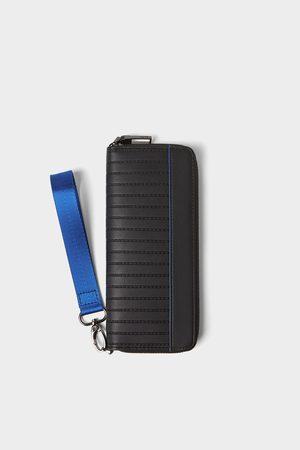 Zara Carteira xl preta com pormenores azuis