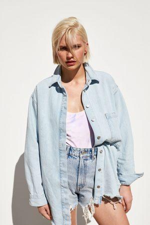 Zara Camisa comprida denim com bolso