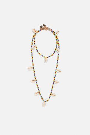 Zara Pack de fio e pulseira de pé com conchas