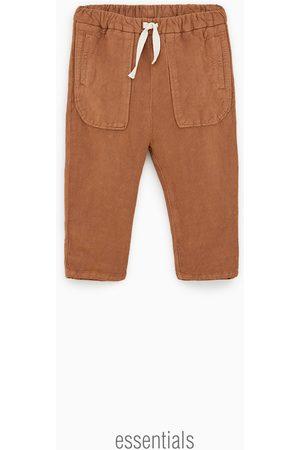 Zara Calças com estrutura e bolsos
