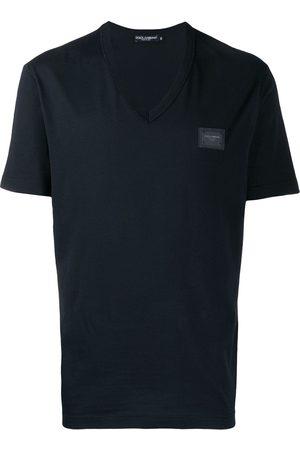 Dolce & Gabbana Homem T-shirts & Manga Curta - V-neck logo T-shirt