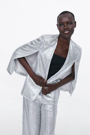 Zara Capa com aberturas e brilhos