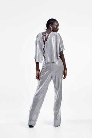 Zara Macacão com manga capa e brilhos