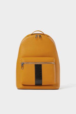 Zara Mochila amarela com detalhe de banda