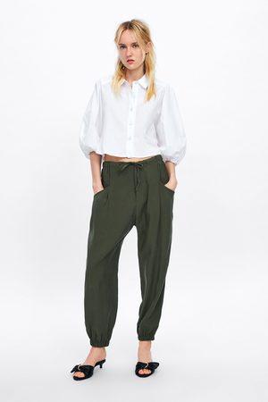 Zara Calças de estilo pijama com bolsos