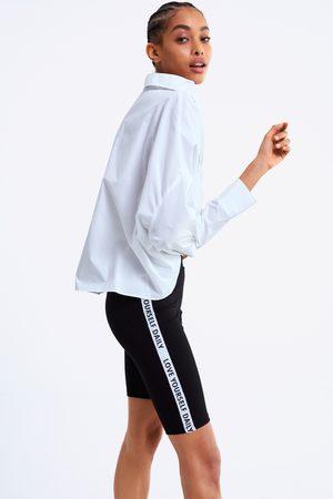 Zara Leggings ciclista com faixa lateral com mensagem
