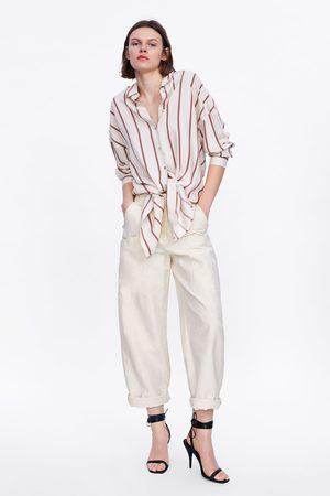 Zara Calças com bolsos laterais