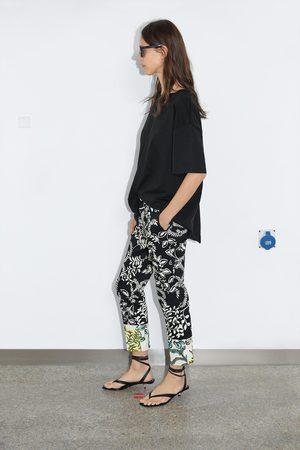Zara Calças chino estampadas