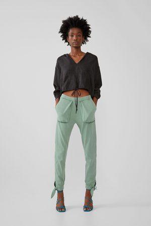 Zara Calças com efeito lavado com bolsos