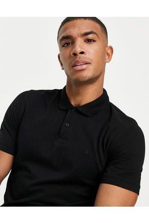 Jack & Jones Essentials slim fit pique logo polo in black