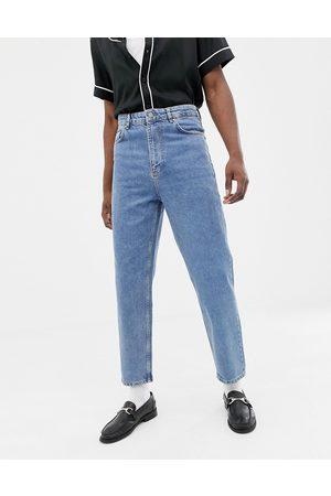 ASOS DESIGN High waisted jeans in vintage mid wash blue