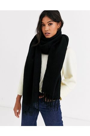 ASOS Supersoft long woven scarf with tassels in black