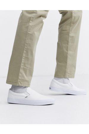 Vans Classic Slip-On plimsolls in white