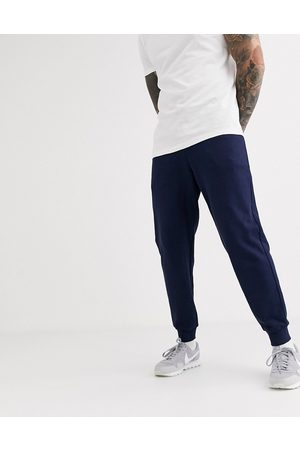 ASOS Organic tapered joggers in navy
