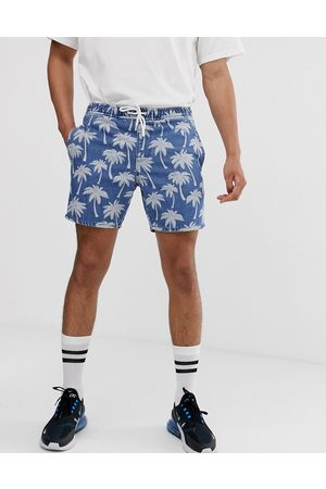 ASOS Denim shorts in mid wash blue palm print with elasticated waist in shorter length