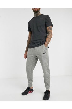 Nike Homem Joggers - Tapered joggers in grey marl