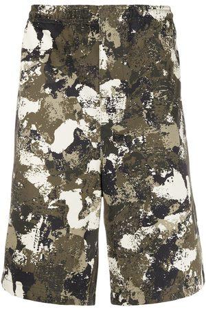 MARCELO BURLON Camouflage print bermudas