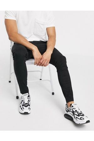 ASOS Power stretch chinos in black