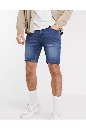 ASOS Skinny denim shorts with power stretch in dark wash blue