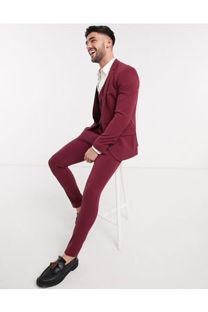 ASOS Homem Calças Justas - Super skinny suit trousers in burgundy in four way stretch-Red