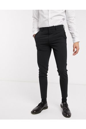 ASOS Super skinny suit trousers in four way stretch in black