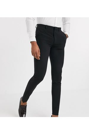ASOS Tall super skinny suit trousers in four way stretch in black