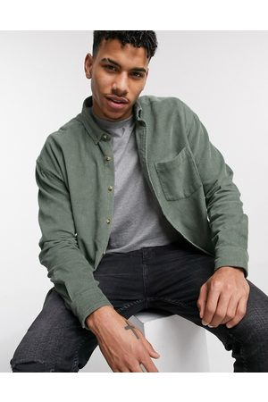 ASOS Homem Casual - Oversized 90's style cord shirt in sage green-Red