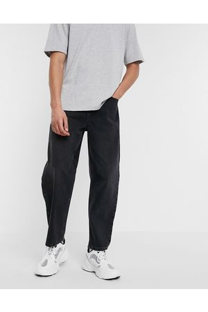ASOS Homem Tapered - Relaxed tapered jeans in black