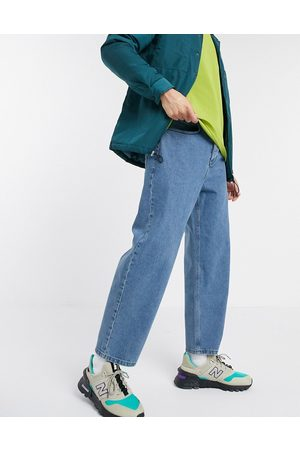 ASOS DESIGN Relaxed tapered jeans in mid wash blue
