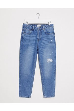 ASOS Homem Slim - Classic rigid jeans in mid wash blue with rips