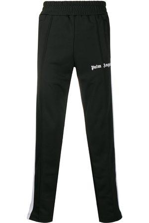 Palm Angels Homem Calças Justas - Logo-print slim track pants