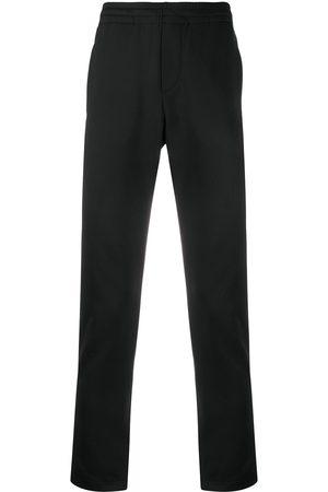 VALENTINO Logo-print slim track pants