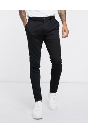 Jack & Jones Intelligence slim fit jersey trousers in black
