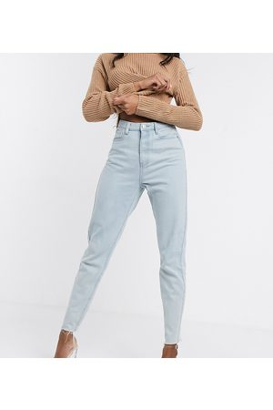 Missguided Mom jeans with raw hem in light wash blue
