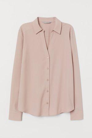 H&M Blusa com decote em V