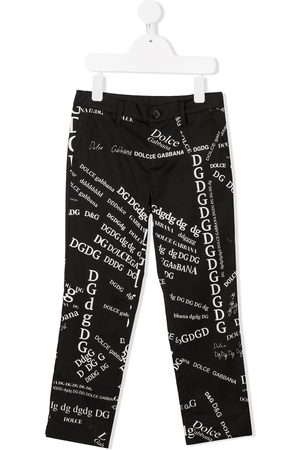 Dolce & Gabbana All-over lettering print trousers