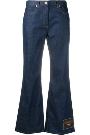 Gucci Flared jeans with logo patch at leg