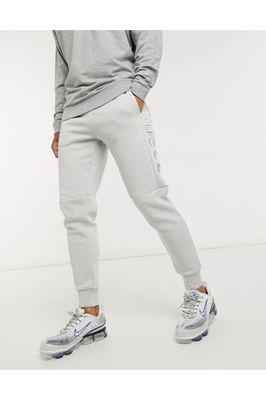 Nicce London Homem Joggers - Embroidered logo mercury joggers in stone grey