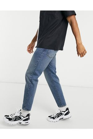 ASOS Classic rigid jeans in vintage dirty wash blue