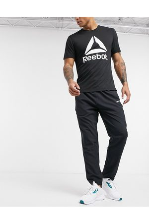 Reebok Training joggers in black