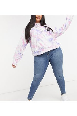 COLLUSION Plus x001 high waisted skinny jean in mid blue