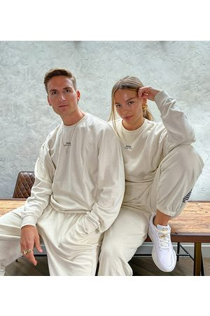 PUMA Oversized joggers in washed stone - exclusive to ASOS-White