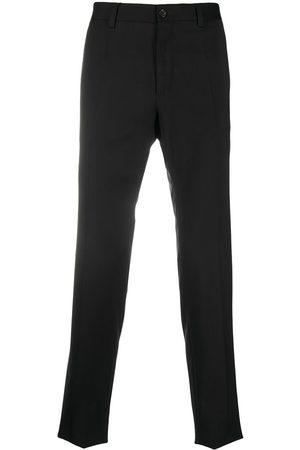 Dolce & Gabbana Homem Calças Formal - Side-strap virgin wool trousers