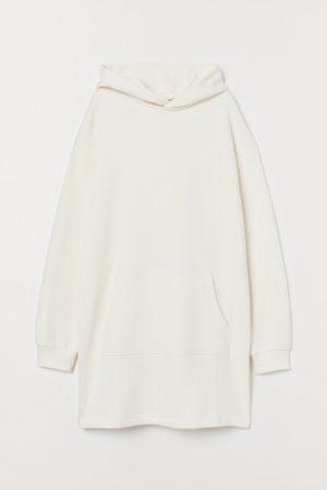 H&M Vestido sweat com capuz